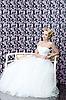 Bride full length sitting portrait   Stock Foto
