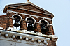 Pediment of house with three bells | Stock Foto