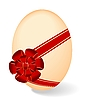 by Easter egg with red bow