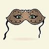 green eyes hidden under theatrical mask