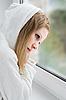 ID 3104913   Beautiful young sad girl at the window   Foto stockowe wysokiej rozdzielczości   KLIPARTO