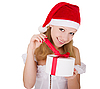 Young girl in Christmas hat with gift | Stock Foto