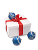 Photo 300 DPI: white box with red ribbon and Christmas decorations