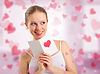 Beautiful girl reads valentine`s day card | Stock Foto