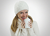 Girl in winter hat and scarf with hot drink | Stock Foto
