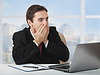 Surprised frightened businessman looking at laptop | Stock Foto