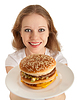 Photo 300 DPI: attractive young woman holds out plate of fast food