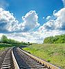 Photo 300 DPI: railway goes to horizon in green landscape