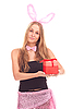 Girl dressed as rabbit with gift | Stock Foto