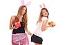 Two girls dressed as rabbits with gifts | Stock Foto