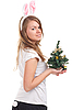Girl dressed as rabbit with Christmas tree | Stock Foto