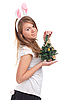 Photo 300 DPI: Girl dressed as rabbit with Christmas tree in the hands
