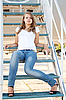 Beautiful girl sitting on the airplane gangway | Stock Foto