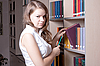 Beautiful girl in the library | Stock Foto