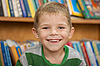 Small boy smiling and the books | Stock Foto