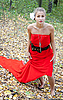 Pretty girl in red dress in the forest | Stock Foto