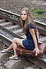 Woman sitting on rails | Stock Foto