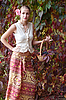Girl in long skirt with basket of grapes | Stock Foto