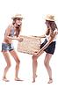 ID 3107652 | Dwie dziewczyny w słomianych kapeluszach z walizką słomy | Foto stockowe wysokiej rozdzielczości | KLIPARTO
