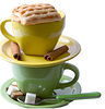 Photo 300 DPI: Green and yellow cup with piece charlotte, coffee bean