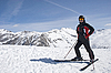 Man in the mountain-skiing form against mountains | Stock Foto