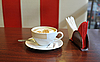 Cup of coffee on table in cafe | Stock Foto