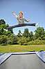 Photo 300 DPI: young gymnast jumps on trampoline