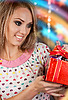 Happy young woman with gift | Stock Foto