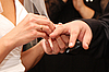 Woman dresses wedding ring on finger to man | Stock Foto