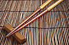 Chopsticks on brown bamboo mat | Stock Foto