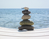 Photo 300 DPI: stack of pebble stones in zen concept on chaise longues