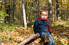 Cute boy and autumn forest | Stock Foto