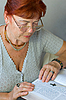 Senior woman reads Bible | Stock Foto