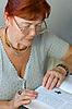 Photo 300 DPI: senior woman reads Bible