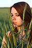 Young woman and cereal crops | Stock Foto
