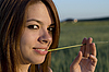 Young woman and straw | Stock Foto
