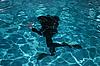 Photo 300 DPI: Diver moving underwater