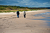Seniors walking on beach | Stock Foto