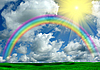 Rainbow, sun, clouds and green grass | Stock Foto