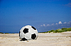 Photo 300 DPI: Soccer ball on sandy beach