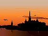 Vector clipart: Silhouette of Stockholm at sunset