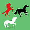 Vector clipart:  silhouette of the horses on green