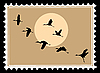 silhouette flying cranes on postage stamp