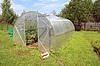 시골 농가의 비닐 온실   Stock Foto