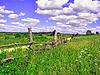 Old fence on field near roads | Stock Foto