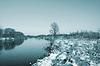 Winter snow on field near river   Stock Foto