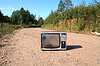 Photo 300 DPI: old television set on road