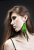 Photo 300 DPI: Young pretty girl with green earrings