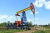 Photo 300 DPI: oil pump against sky