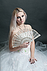 Beautiful girl in white dress with fan | Stock Foto